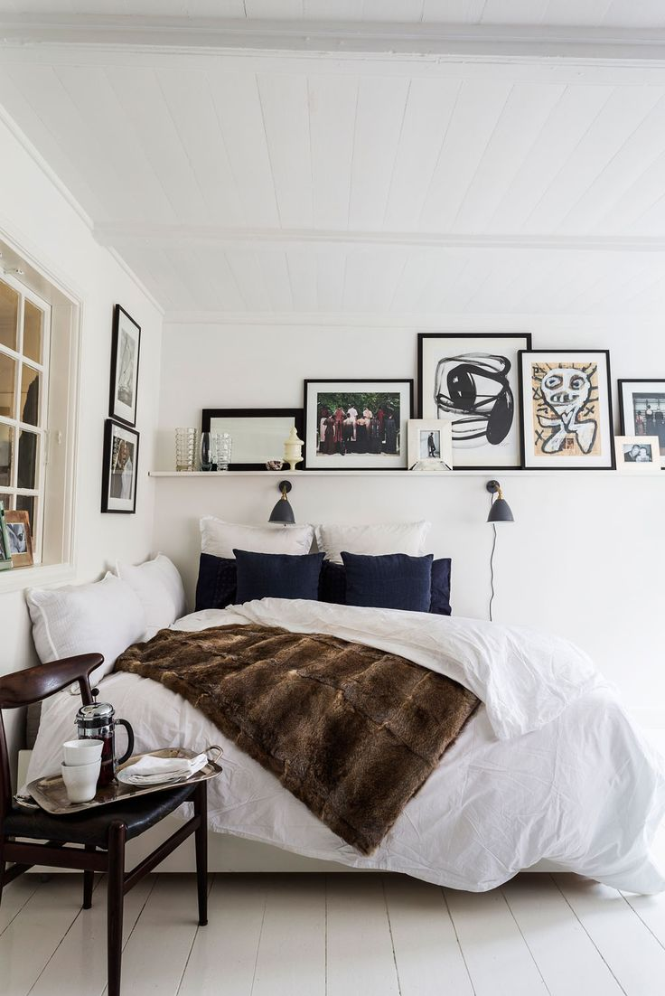 Blue black and white multifunctional studio apartment with great art gallery walls are dream roomswhite studio apartmentmodern