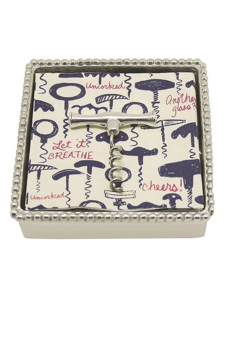 "Unwind, enjoy a proper cocktail and add just a bit of cheer with this corkscrew-themed beaded napkin box. Weight sits atop a stack of blue, red & ivory corkscrew motif napkins. Designed by Michael Updike and beautifully crafted in recycled sandcast aluminum. Perfect hospitality gift idea and packaged in a Mariposa signature aqua gift box.    Measures 5 3/4"" square x 1 1/2"" high.   Corkscrew Napkin Box by Mariposa. Home & Gifts - Home Decor - Dining - Table Accessories Massachusetts"
