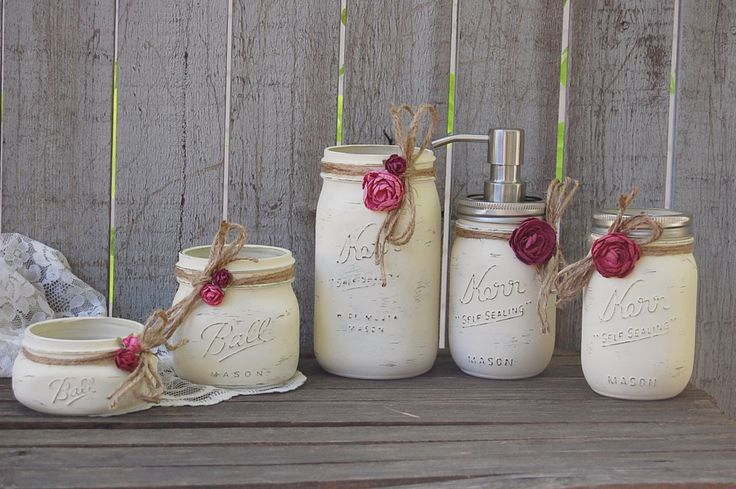 Shabby chic mason jar bathroom set. Hand painted in soft ivory, tied with jute and a orchid and deep pink roses, finished with a protective coating. Metal soap dispenser, toothbrush holder, make up br