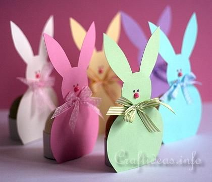 Spring and Easter Paper Craft ...Easter Bunny Paper Egg Holders ...They are a cute decoration and at the same time hold an hard boiled egg on their backsides. You can choose to make your bunnies as colorful as you like like these six bunnies or just in one color for a quieter, more pulled together look.