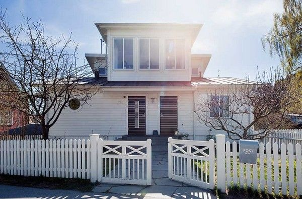 Charming Home with White Vinyl Picket Fence and Fascinating Design Details
