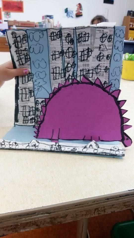"Tracy Triplett's Kindergarten art projects inspired by the book If Dinosaurs Came Back To Life ""We read the book. Folded blue paper""almost in half"" Talked about cities and cityscapes. Added buildings with old phone book pages. Draw dino. Trace w marker. Cut. I cut the pop out paper slits for them. Glue dinosaurs on pop-outs. End of day one. Let dry. Trace buildings and add windows, clouds, etc. Draw cars on folded piece of paper, cut off top so only the cars are showing. Glue in front of…"