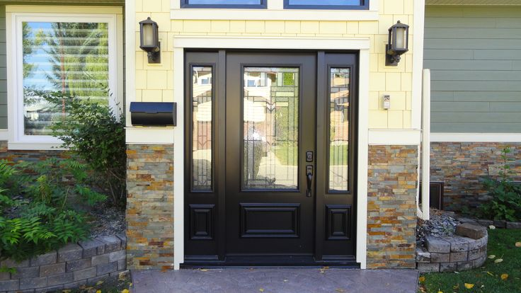 Royston glass insert by trimlite black coloured single entry door with two sidelites doors Exterior doors installation calgary