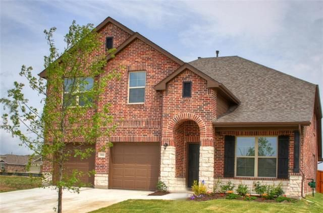 1921 Ridge Creek Lane, Aubrey TX  Beautiful 5 BR 4.5 Bath home with the master and study down, shows like a model on a premium cul-de-sac lot with view to green space with mature trees and pond. Open, spacious floor plan with a study, extra large game room two living and dining areas with lots of storage space. Nicely updates with his & hers closets, extensive wood floors, 6 inch baseboard, crown molding, wrought iron stair railings, recess lights, high vaulted ceilings, tray ceilings, 42…