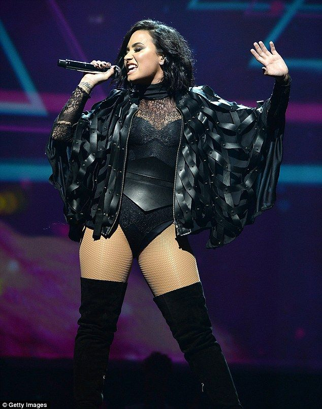 Racy romper: Demi Lovato donned a skintight black lace bodysuit at her Future Now concert in Brooklyn, New York on Friday night