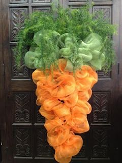 "Deco Mesh Carrott ....Purr-fect for Easter!!    1. Half cone form  2. Buy one roll of 21""X10 yards of orange mesh  3. 21""X10 yards of green mesh  4. Make 4 inch mesh bows with approximately 8 inch loops to tie on each of the twist ties to cover the top two rows with green  5. Begin with the orange 21 ""X10 yards to the bottom of the cone the narrowest end  6. You can add asparagus, or fern to shoot out the top to create a stalk-like effect  7. Enjoy your DIY carrot!"