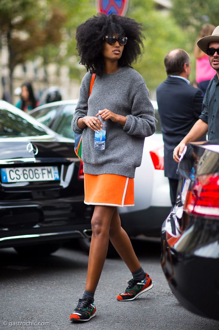 Grey sweater layered over a bright orange mini skirt + sneakers #StreetStyle