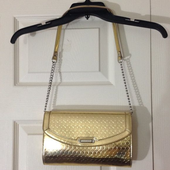 "Nine West gold circle pattern shoulder-carry purse Gold in color, rectangular in shape.  Synthetic leather, debossed pattern of circles, shiny finish.  All metal components are silver-tone.  Brand new without tags.  ⚠️ PRICE FIRM ⚠️  Measurements are as follows:  9 ½"" across, 5 ¾"" tall, 2"" deep, approx. 13"" strap drop (strap is NOT detachable).  Note:  Strap will be folded inside the purse when you receive it. Nine West Bags Shoulder Bags"