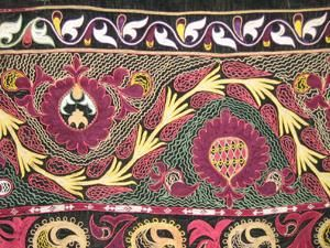 Fragment of an antique Tush Kiyiz. Embroidery was a must for every Kyrgyz girl: she was tought this art from the very young age. And usually it became a lifelong occupation and kind of a rivalry - embroidery was both on clothes and home decoration.