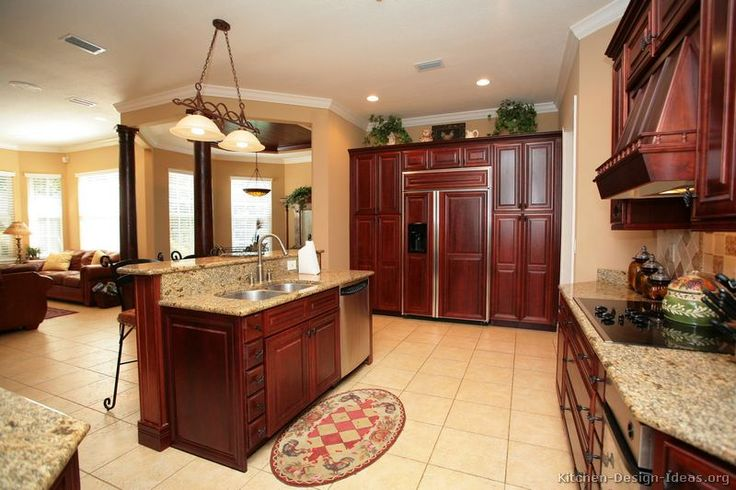 Galley Kitchen dark cherry cabinets, panel for fridge and ...