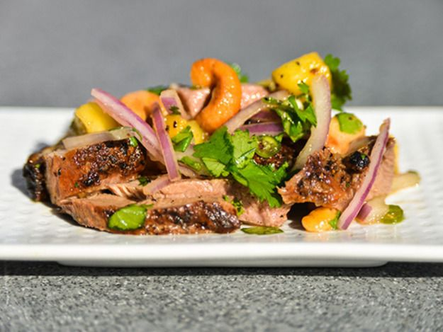 An intoxicating juxtaposition of flavors, including spicy and salty lime dressing, sweet pineapple, nutty cashews, and lightly smoky duck, make this a salad of the highest order.