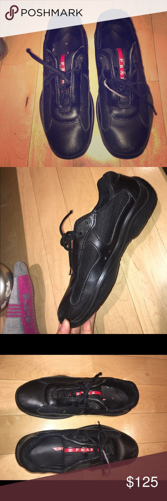Authentic Women's American Cup Prada Sneakers Authentic Prada black sneakers, black tongue with red Prada logo in the middle. Good condition. Laces need to be replaced. Slight wear and tears Prada Shoes Sneakers