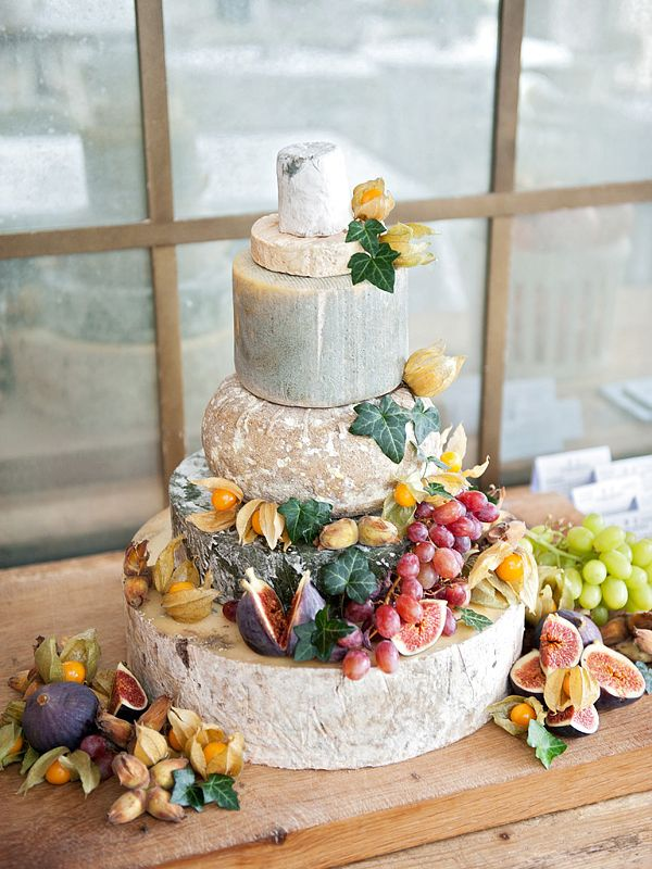 brilliant! a wedding cake made of cheese! guests take home a wedge as a favor. i hate cake. for the next time i get married... ;)