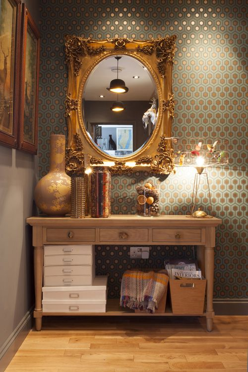 Sophisticated, collected arrangement for entry way with gorgeous Cole and Sons wallpaper as a backdrop.
