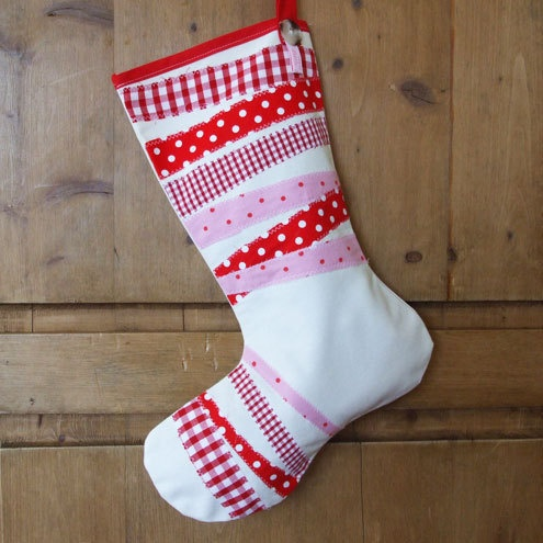 Red Striped Christmas Stocking £20.00 from Edie Sloane