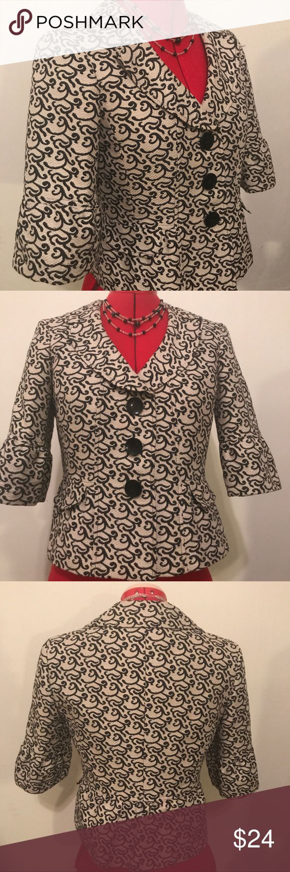 """NINE WEST cropped-sleeve jacket Sz 2 Nine west 3-button cropped jacket with flattering portrait collar & elbow-length sleeves. Nylon-cotton fabric has a luxe texture in off-white with an elegant black pattern reminiscent of calligraphy. The overall effect is very chic. Perfect to pair with a black pencil skirt or black pants for the office or business meeting. A generous Size 2 measures abt 16"""" across shoulders, abt 36""""chest & 22"""" Long. Sleeve is 13"""" A slight peplum and similar ruffle on…"""