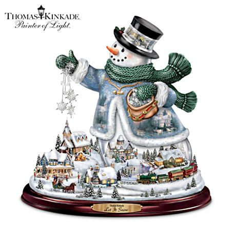 #DecktheHalls       Thomas Kinkade Snowman With Lights, Animated Train, Music.  Limited-edition snowman with Thomas Kinkade artwork, sculptural village, lights, animated train, music, Swarovski® crystals, more.