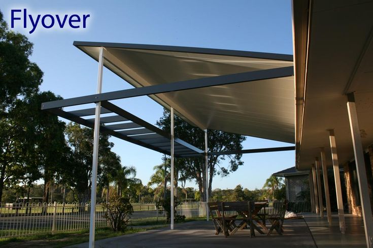 For a stylish pergola that is customised to suit your home, why not give it a wonderfully dramatic flyover roof. #patiodesign