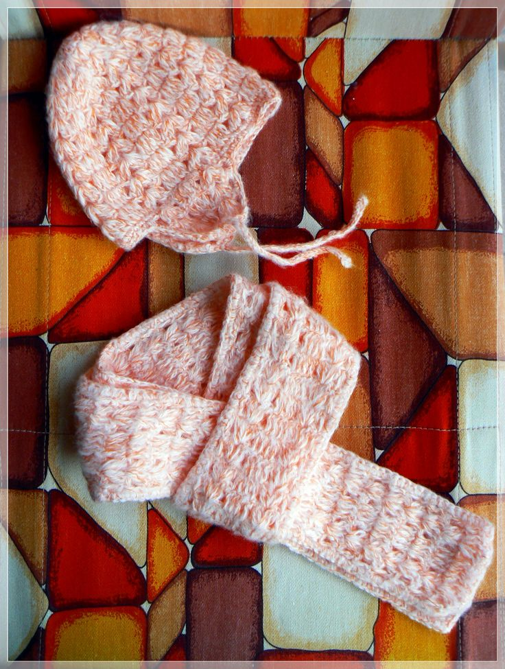 Orange and white crochet set for small child.