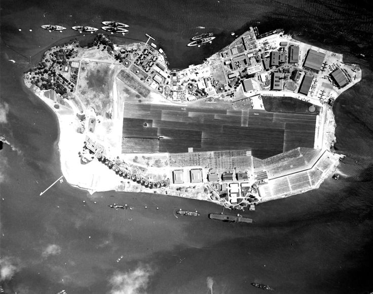 Vertical aerial photograph of Ford Island, Pearl Harbor, US Territory of Hawaii, 10 Nov 1941; note Battleship Row on top, USS Lexington at bottom, and PBY aircraft at upper right
