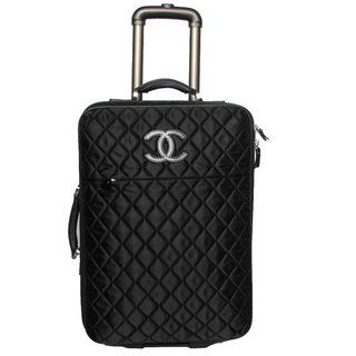 CHANEL LUGGAGE I bet this is soft as butter...i love the simple quilt