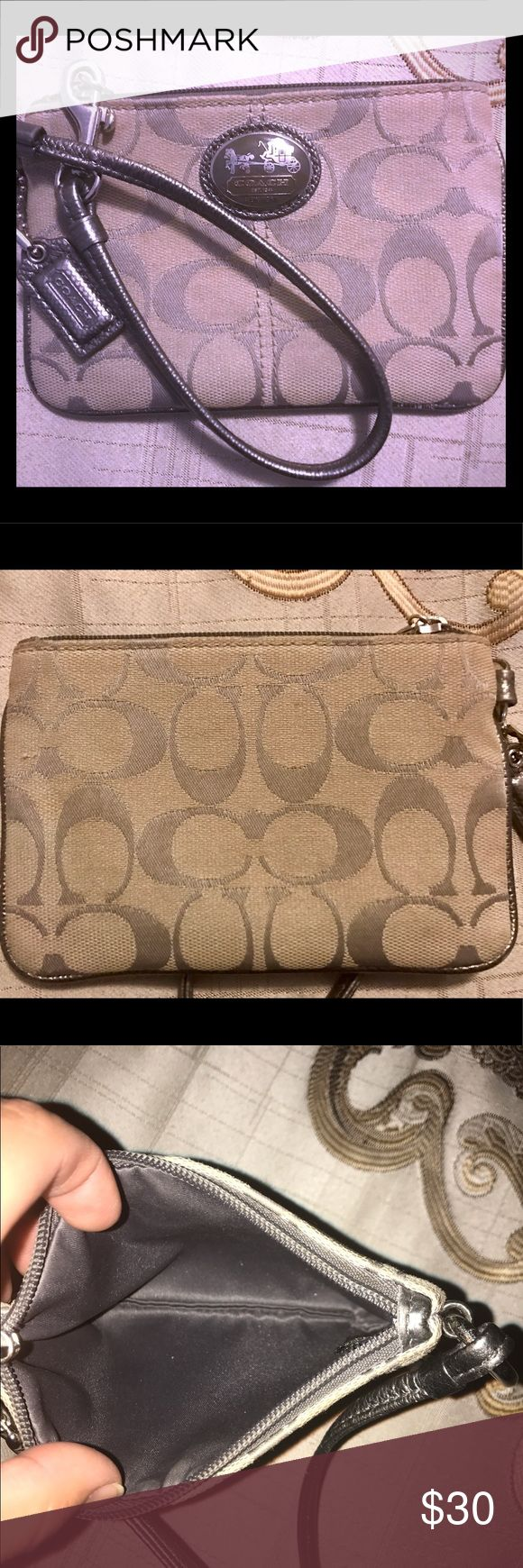 Coach Wristlet  Coach Wristlet in well condition. Shows only slight wear.  I retired this wristlet so now it is time for you to love and enjoy! Amazing price on this wristlet! Never tried to spot clean. Coach Bags Clutches & Wristlets