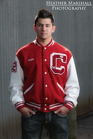 Want the letterman jacket unbuttoned w/ a tie, but love the old rustic background... maybe old wood building?