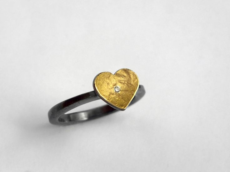 Minimal gold and oxidized silver heart ring with a diamond and a hammered band. by TomisCraft on Etsy