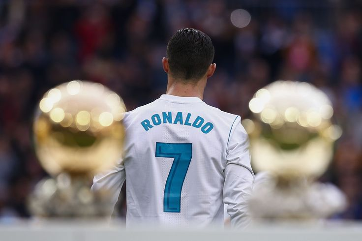 Cristiano Ronaldo Photos - Cristiano Ronaldo of Real Madrid CF walks to the pitch after posing with his five Golden Ball (Ballon d'Or) trophies   prior to start the La Liga match between Real Madrid CF and Sevilla FC at Estadio Santiago Bernabeu on December 9, 2017 in Madrid, Spain . - Real Madrid v Sevilla - La Liga