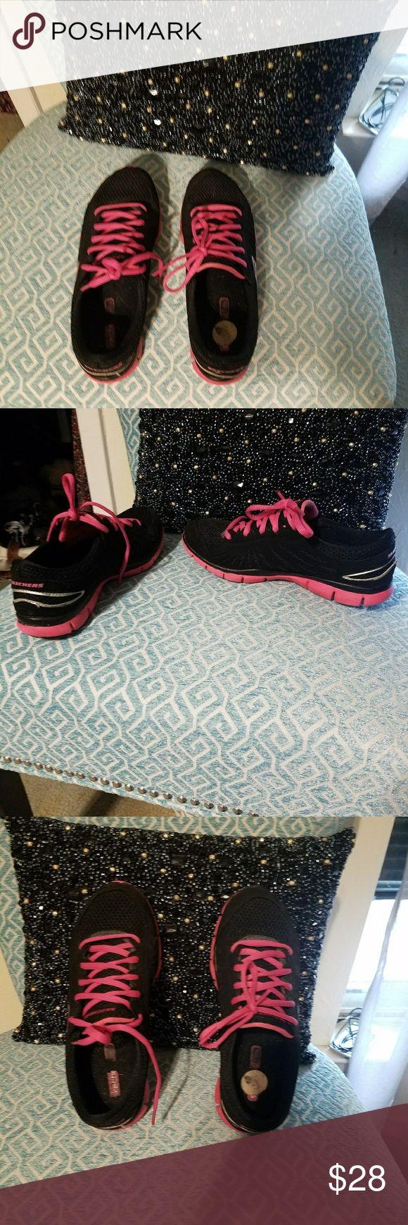 Skechers Sneakers Black with pink skechers. Good condition. Skechers Shoes Sneakers