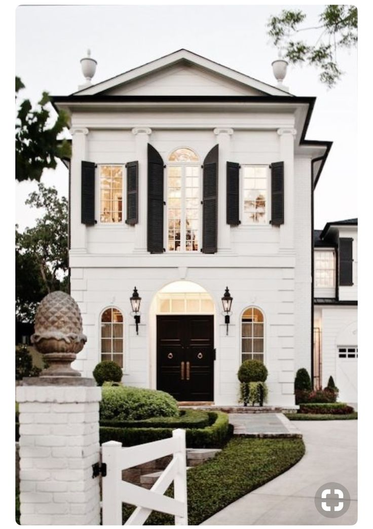 A petite yet tall elegant home with white exterior, shutters, arched windows, and curb appeal to the max. #houseexterior #eleganthome