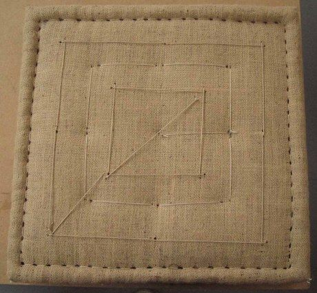 Traditionally upholstered square seat pad.