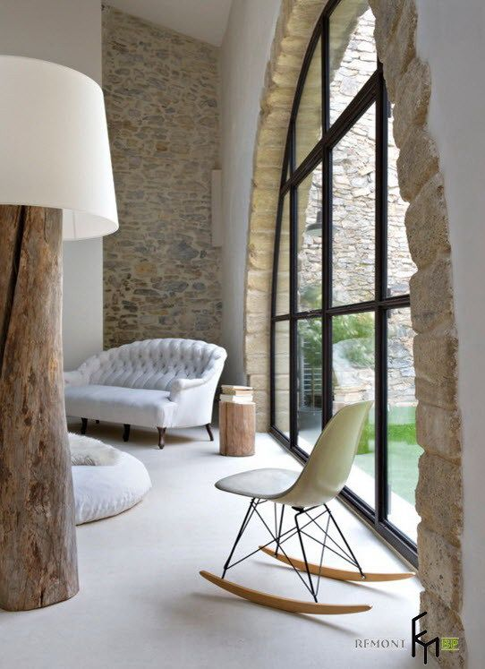 A Stunning Stone Wall Arched Window Design With A Simply Cream Wooden Rockingchair With White Sofa For Relaxing Beautiful Country House in Italy with Warm Interior Home design