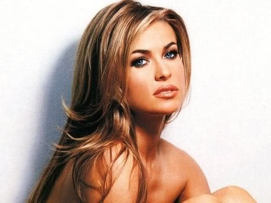 carmen electra, the blonde highlights mix in with her natural brown color well a her layers are beautiful