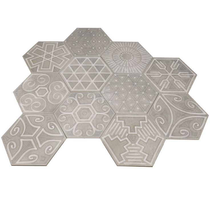 Klinker Hexagon Igneus är en sex-kantig klinker i grått, med blandade etniska mönster från spanska Vives.