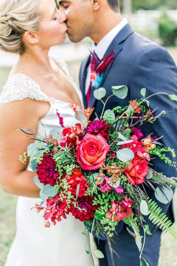 bouquet with red flowers - photo by L Martin Wedding Photography http://ruffledblog.com/backyard-florida-wedding-with-cobalt-bridesmaid-dresses