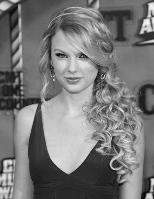 Side swept, curly, with a headband to top it all off! Would be perfect for prom