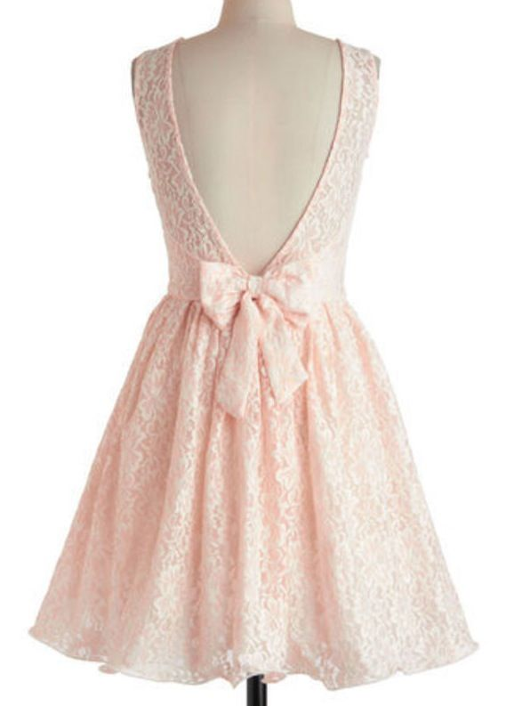 Pink lace dress with a bow in the back
