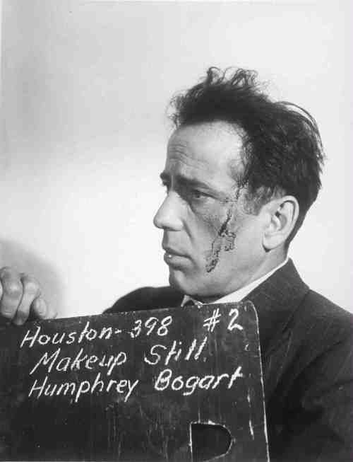 Make-Up Screen Test for 'The Maltese Falcon' (1941) - Humphrey Bogart as detective Sam Spade, with bloody bruises.. Note: John Huston was making his directorial debut; his name is misspelled on the slate.