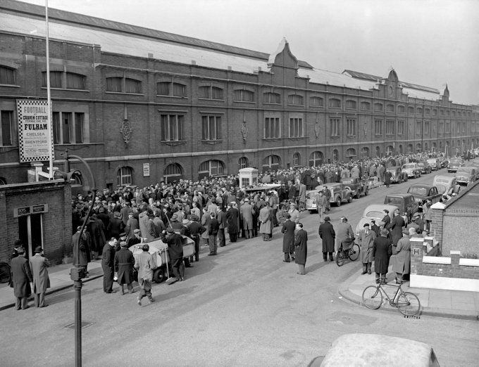 1958. Fulham fans queue down Stevenage Road as they wait for 12,000 tickets for the club's FA Cup Semi Final Replay against Manchester United to go on sale