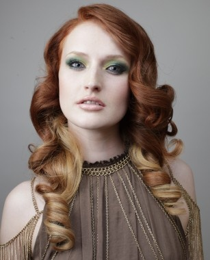 Pretty red and blonde ombre hair.    A long red straight curly coloured multi-tonal hairstyle by L'Oreal