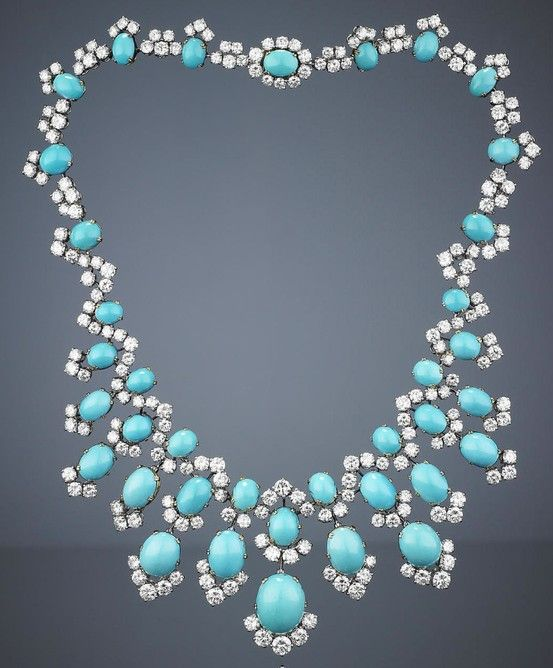 A turquoise and diamond necklace, by Bulgari, 1960s. Of fringe design, the front of the necklace composed of twelve pendants, each set with oval turquoise cabochons, accentuated by brilliant-cut diamond partial surrounds, suspended from a similarly-set undulating neckchain, signed Bulgari, inner circumference 35.0cm