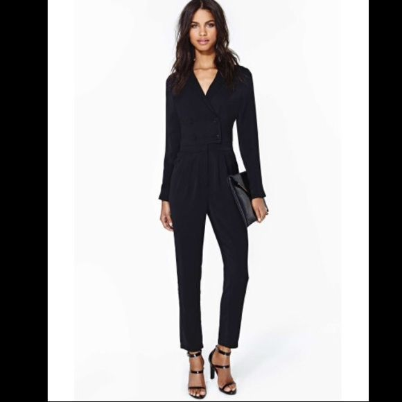 Line & Dot Tuxedo Jumpsuit Very flattering and comfortable jumper by Line & Dot.  Vintage-inspired jumpsuit with sleeves featuring a double breasted front. Loose fit with a cinched waist. Pockets at sides. Zip fly. Polyester/spandex mix. Line & Dot Other