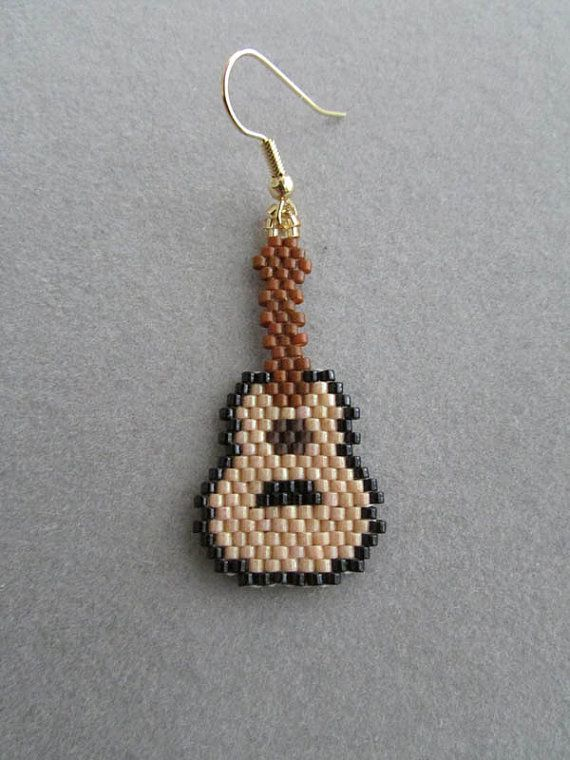 An acoustic guitar, in earring form. They measure 7/8-inch wide and are about 1-3/4-inches long, excluding the ear wires. They are created using the brick stitch and approximately 376 tiny delica beads intricately woven together, one bead at a time, to create the earrings you see here.  They would make a great gift for the guitar player or music lover in your life, or maybe a treat for yourself!  The pierced fishhook ear wires are gold plated surgical steel. If you would prefer that...