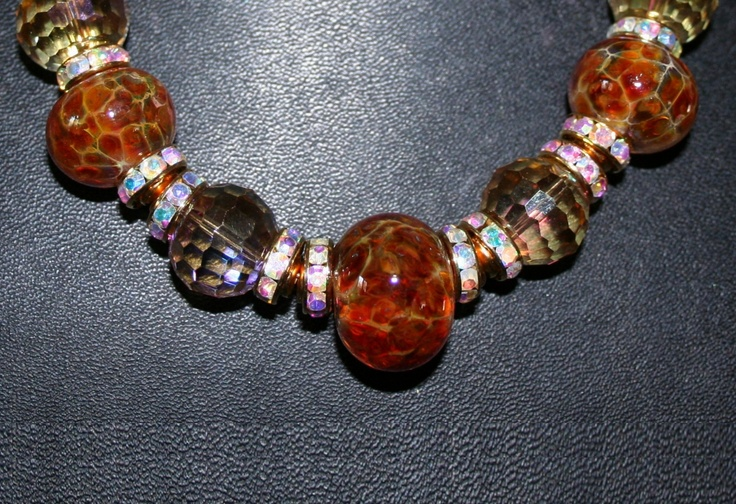 Crystal Leopard - Wonkets Necklace (lampworking) - This exotic necklace is made from beautiful amber toned leopard Wonkets, highlighted by crystal and gold-toned findings. It's 15 1/2 inches, with a 2 1/2 inch extension chain.
