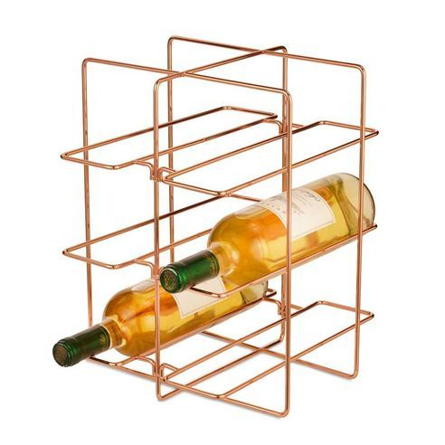 Display your wine bottles in style and keep them within easy reach with our minimalist Lincoln Copper Wine Rack from Design Ideas. This handy table top bottle rack can hold six bottles of wine in total and is a great finishing touch to any dining room or kitchen. It makes for a perfect housewarming gift too.The Lincoln Wine Rack is made from metal wire with a smart on-trend copper finish.Part of the Design Ideas Lincoln Collection which includes a wide range of organisational items for the…