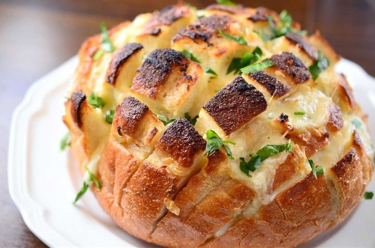 Roasted Garlic and Brie Pull Apart Bread. Try grilling. Look at other bread pull apart bread for grill directions.