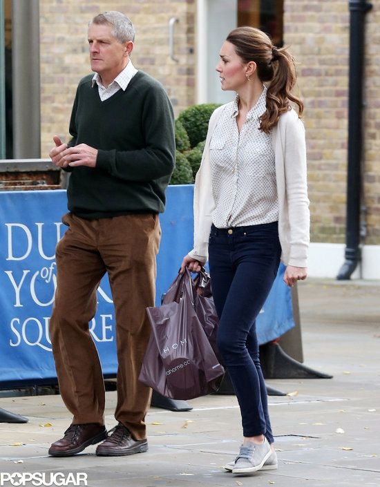 Exclusive: Kate Middleton Bargain Shops in Sneakers!: Kate Middleton walked with a friend through London.