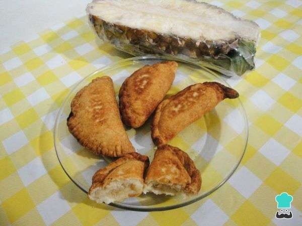 Colombian Empanadas with Pineapple Filling Recipe #pineapple #empanada #dessert #easy #cornmeal #glutenfree #filling #LatinAmericanfood #Colombian #baked #delicious #pastry #snack