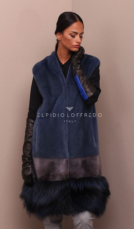 Female Mink Vest with Silver Fox Fur whole skins. Made in Italy. Skins Quality: KOPENHAGEN PLATINUM – SAGA ROYAL; Color: Avion – Blue – Grey; Closure: With hooks; Collar: Plat; Lining: 100% Satin; Lining Color: Monocolor; Length: 97 cm;